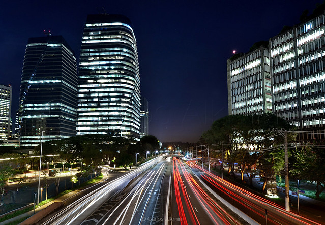 Sao Paulo Expressways - Juscelino Kubitschek Avenue and its traffic in both ways through the lights of moving cars, between corporate towers of distinct generations
