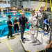 "Canadian Space Agency astronaut David Saint Jacques helps Astronaut Col. Tyler N. ""Nick"" Hague prepare to be lowered into a pool with a mockup of the International Space Station (ISS) for Extravehicular Activity (EVA) training at the Johnson Space Flight Center's Neutral Buoyancy Laboratory (NBL) in Houston, Tex., Apr. 27, 2017. During  training at NBL, Hague wears a spacesuit to simulate the near weightless environment he will encounter while performing EVAs, or spacewalks, while serving as a flight engineer on Expedition 54/55 aboard ISS in 2018-2019.  (U.S. Air Force photo by J.M. Eddins Jr.)"