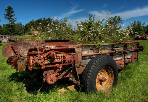 wisconsin outdoors rusty manurespreader washburn bayfieldcounty farmmachinery farming flowers wildflowers geotagged northwoods northernwisconsin digital canon canoneos hdr tonemapping photomatix midwest america northamerica usa summer farm rural country countryside washburnwisconsin agriculture