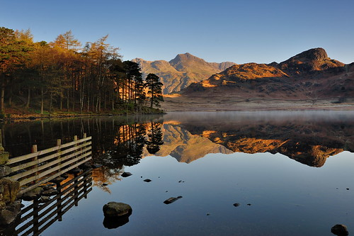 bleatarn light langdales tarn first calm fence dry stone wall rocks stones boulders shore shoreline mist misty lake cumbria lakedistrict lakeland view scenic thelakes lakedistrictnationalpark nationaltrust fell fells grass cumbrian mountains landscape imagestwiston district national park countryside mountain super golden hour still water reflection reflections morning mirror spring blue cloudless englishlakedistrict lakes thelakedistrict reflected waterreflections sunrise dawn stupidoclock wideangle wide angle sidepike lingmoorfell pikeoblisco pikes greatlangdale littlelangdale pine scotts hff happy friday unesco worldheritagesite