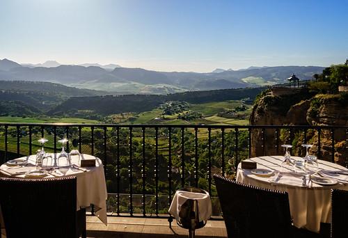ronda andalucía spain es 2015 balcony cafe hotel landscape lattice light mountain plant rock town tree village