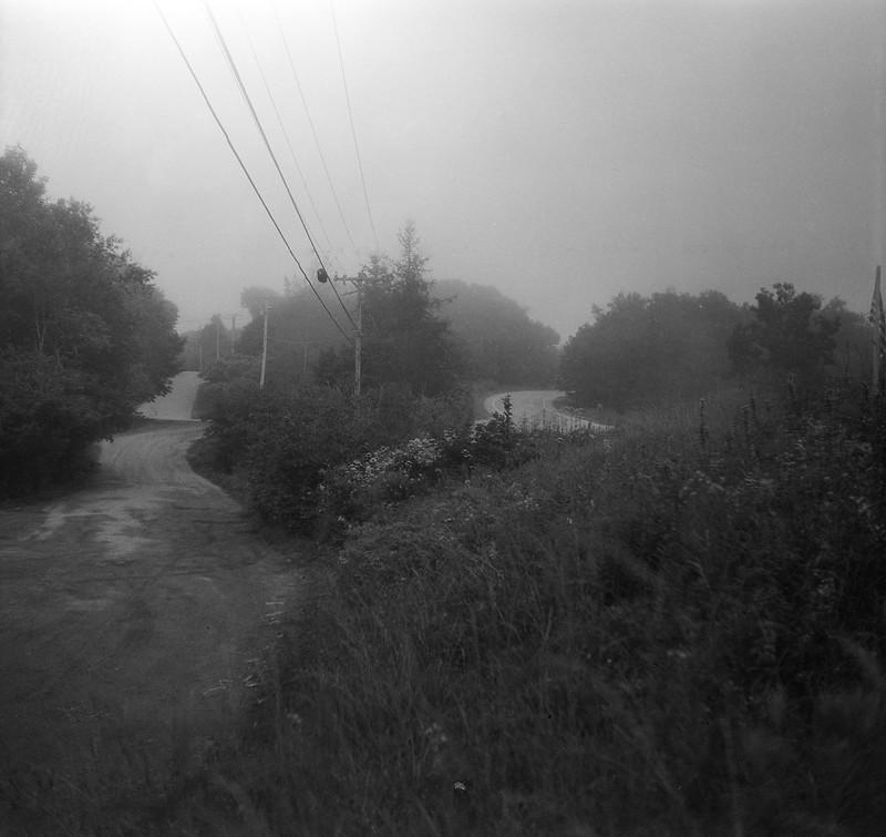 dirt road (left), Route 131 (right), fog, power lines, near dusk, Saint George, Maine, Welta Weltur, Arista.Edu 200, Moersch Eco Film Developer, late July 2017