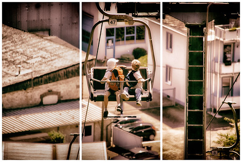 triptych cablecar aged children lookingaround cars rooftops 47 high backpack saarburg sesselbahn view germany slta58 sigma18300mm seatcablecar houses dust