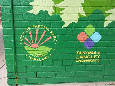 I am impressed that the City of Takoma Park and the Takoma Langley Crossroads CDA put their logos on this mural at Holton Lane