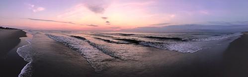 sunrise dawn breakingdawn oceansunrise beach shore shoreline waves pink purple reflecting reflectingsand obx outerbanks currituck corolla nc northcarolina pano panorama panoramic ripples tides clouds sky raspberry iphone jennypansing horizon ocean atlanticocean