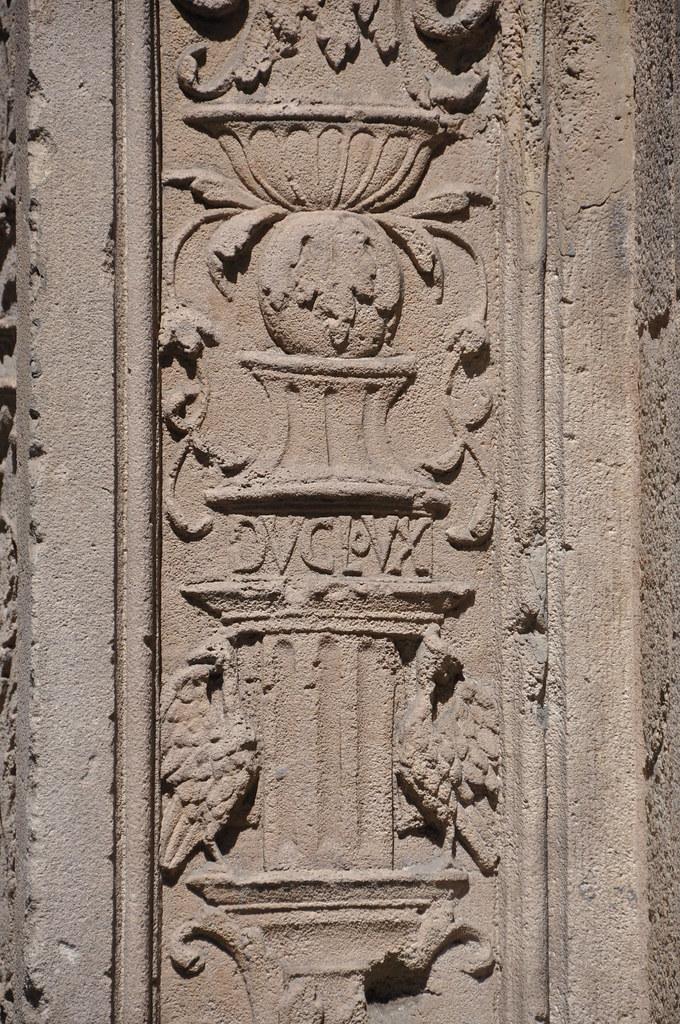 Barcelona (Ample street).  Grotteschi. Detail of the former portal of Sant Miquel church, reconstructed in 1872 next to La Mercè. 1516. René Ducloux, sculptor. Gabriel Pellicer and Pau Mateu, builders.