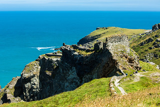 Tintagel Castle sitting proudly on the rock edge.