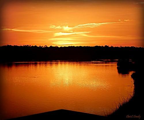 superdoopersunset sprucecreekpark portorangeflorida sunset clouds sky sun reflections creek sprucecreek water wetlands