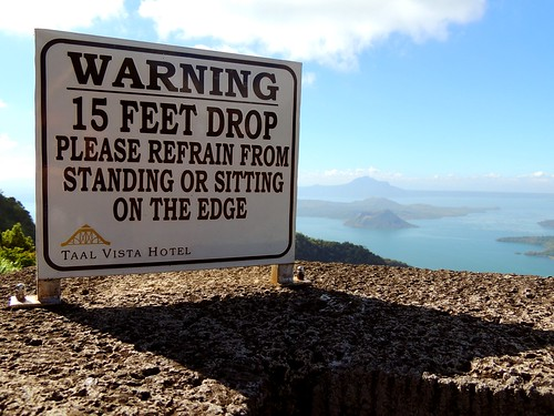 signs warning danger cliff dropoff edge feet drop refrain taal vista hotel resort getaway vacation philippines impressive scenery nature tagaytay pilipinas relax lake water volcano