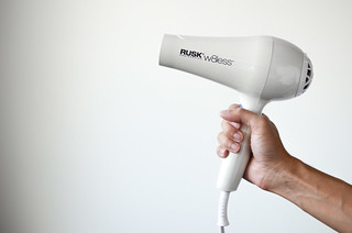 hand holding a white hair dryer | by yourbestdigs