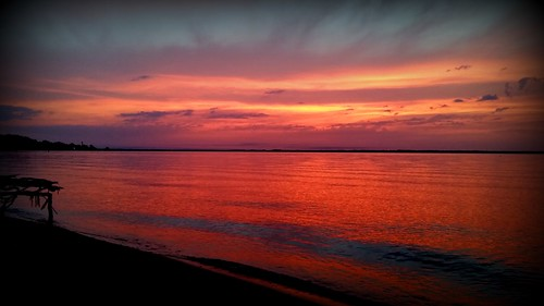 water silhouette clouds sunrise bay shoreline calm shore serene pensacola skyporn