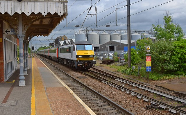 Greater Anglia 90008 'The East Anglian' slows ready to stop at Diss Station, with the 11.30 service from Norwich to London Liverpool Street. 05 06 2017