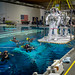 "NASA astronauts USAF Col. Tyler N. ""Nick"" Hague and Jeanette Epps, are lowered into a pool containing a mockup of the International Space Station at the Johnson Space Flight Center's Neutral Buoyancy Laboratory for Extravehicular Activity training in Houston, Tex., Apr. 27, 2017. (U.S. Air Force photo by J.M. Eddins Jr.)"