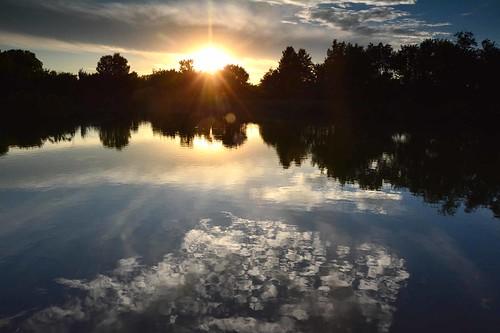 sunset clouds water reflections chisholmcreekpark wichita kansas