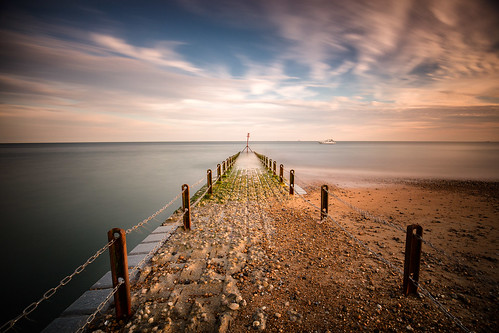 brighton jetty pier pebbles sea seascape seafront seaside wideangle canoneos6d canon1635mmf4is lee superstopper posts stones beautiful milky longexposure waves convergence vanishingpoint adrianpollardphotography sussex england motionblur clouds sunset warmth perspective