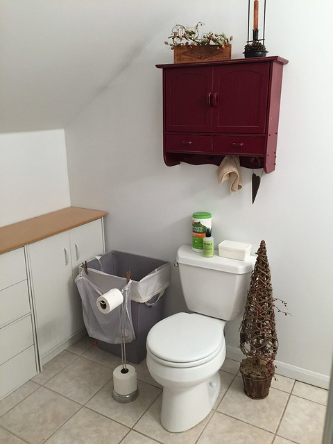 laundry hamper in bathroom