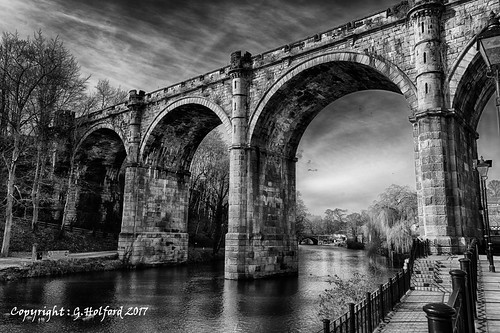 yorkshire knaresborough bridge soaring tall arches nikon d750 hdr blackandwhite monochrome uk england greatbritain arch architecture river water unitedkingdom large looming texture towering clouds stone british waterway embankment heritage engineering grain old spans spanning culture britain bw railings footpath walkway riverbank span spanned crossing steps riverside lamp trees beauty stately vintage enormous textured fave favourite stunning highdynamicrange triplelayered popular wonderful simple three trio archways super superb engineered flying transport faved locality placetovisit vista bellavista beautifulviews
