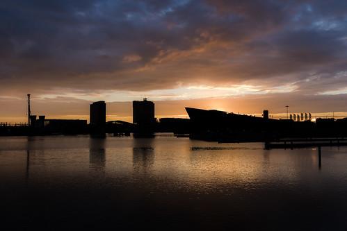 amsterdam sunrise silhouette waterfront cloudscape seascape oosterdok nemo