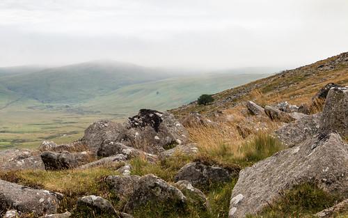 rock hill boulder strewn landscape dartmoor nationalpark mist lowcloud valley outdoor dull summer wilderness moorland