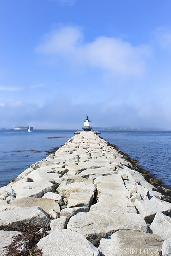 spring point ledge lighthouse head light lighthouses sail sailboat water ocean rocks fort sky clouds blue sea shore beach coast south portland maine seascape landscape nature boat fog