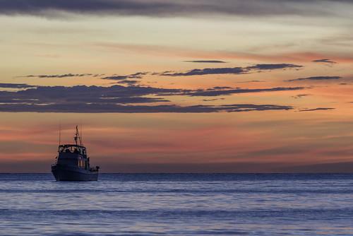 fourthofjuly naples beach gulfofmexico ocean fishingboat tranquil bluehour goldenhour sunset