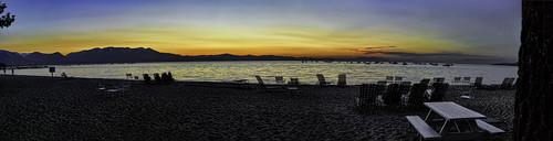 sunset laketahoe southlaketahoe beach chairs mountain boats picnictables trees sky orange blue horizon tahoebeachandskiclub california panoramic panorama water waterpictorial joelach night dusk sundown