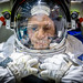 """NASA astronaut Col. Tyler N. """"Nick"""" Hague waits to be lowered into the pool containing a mockup of the International Space Station at the Johnson Space Flight Center's Neutral Buoyancy Laboratory for Extravehicular Activity training in Houston, Tex., Apr. 27, 2017. (U.S. Air Force photo by J.M. Eddins Jr.)"""
