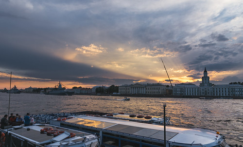 saintpetersburg russia clouds sky skyscape city cityscape building architecture water river neva sun sunset light orange boat
