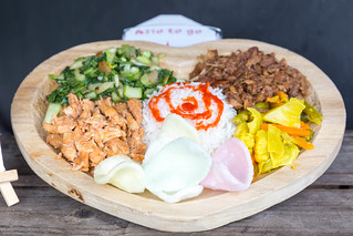Bali Teller: rice, vegetables in curry sauce, chard and two kinds of meat   by marcoverch