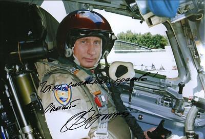 "Vladimir Putin in the cockpit of a Tupolev Tu-160 ""Blackjack"" supersonic strategic bomber in August 2005"
