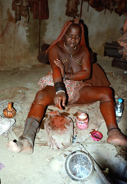 Himba girl  - a traditional make up session!