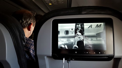Watching the Beatles Deplane an American Airlines Flight while on an American Airlines Flight