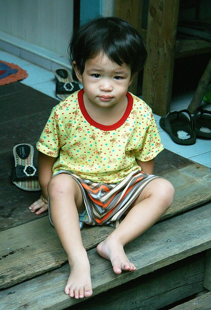 barefoot child on a porch