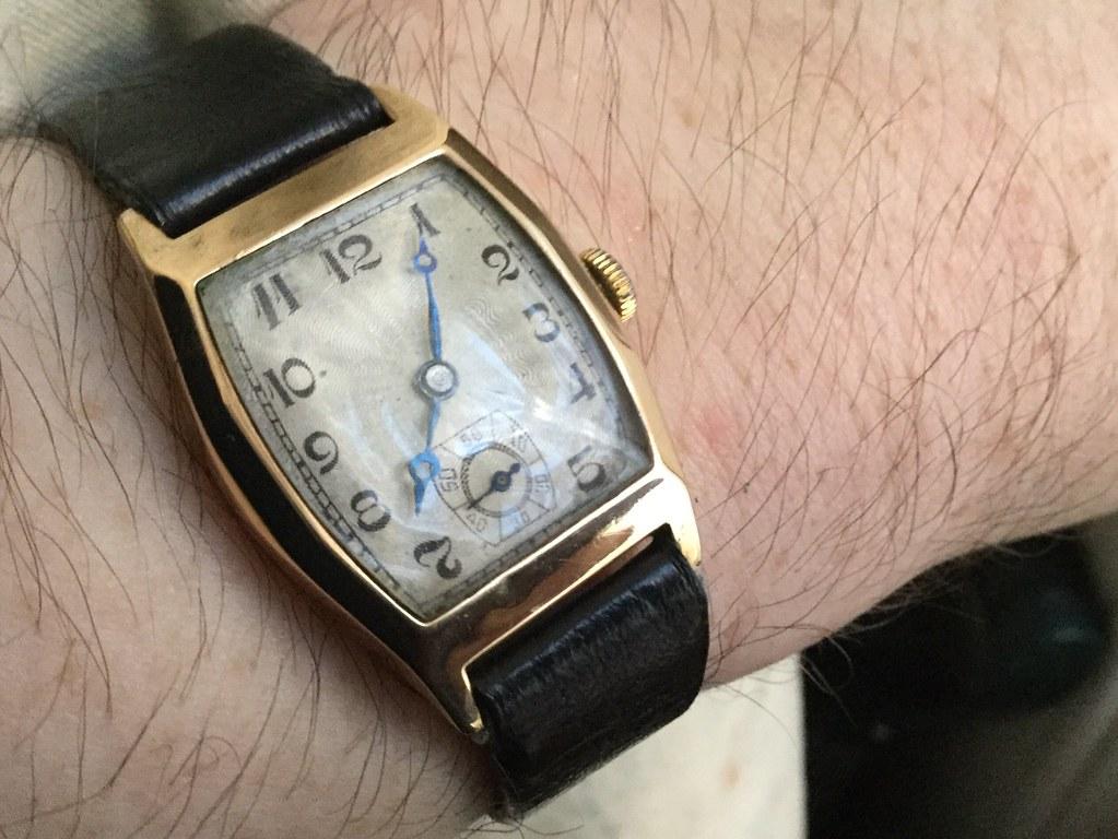 9ct hallmarked 1934, with 1937 inscription tonneau watch.