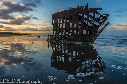 peteriredale fortstevens graveyardofthepacific sunrise ocean beach shipwreck clouds sand waves reflections morning dawn clatsop oregon sea water sky landscape coast