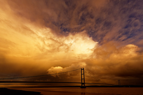 storm apocalyptic stormy rain clouds formation atomspheric glow spectacular england catastrophic bridge river estuary humber skyscape eos1dxmk2 tamron 1530mmf28 crossing 2220m 1981 weatherfront weather eastyorkshire northlincolnshire bartonuponhumber image fullframe wideangle autumn sunlight dramatic outdoor water towers suspension roadway landscape
