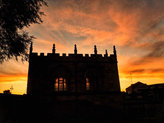 Chapel on the bridge in Rotherham silhouetted against the sunset