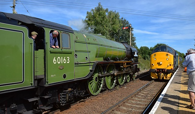 A1 Pacific Locomotive No.60163 'Tornado', at Acle Station, with 'The Easterling' tour from London Kings Cross to Great Yarmouth, as the 13.17 service from Great Yarmouth to Norwich approaches. 28 08 2017
