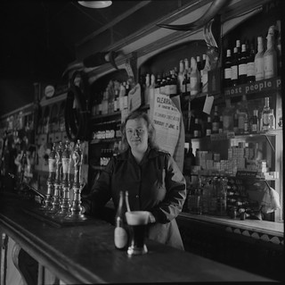 Miss Furey behind the bar, Moyvalley, Co. Kildare | by National Library of Ireland on The Commons