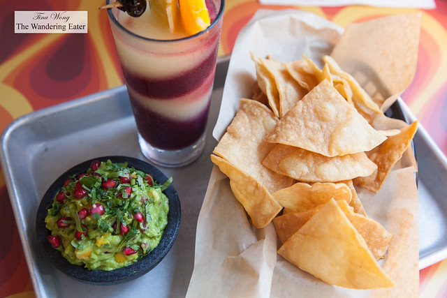 Pomegranate and mango guacamole with housemade tortilla chips with the Tsunami