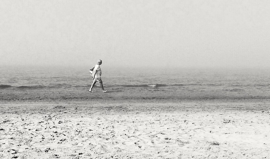Man and fog on the beach