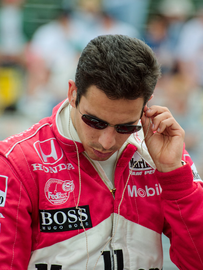 Helio Castroneves prepares to climb aboard his Team Penske racing car at the CART race at Portland International Raceway in 2001