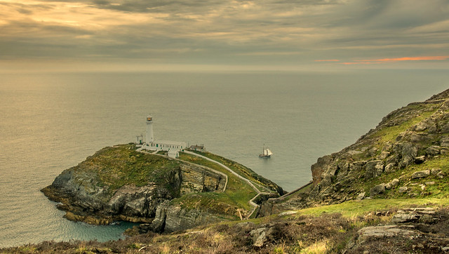 Sailing Ship Passes Southstack Lighthouse At Sunset ... Wales