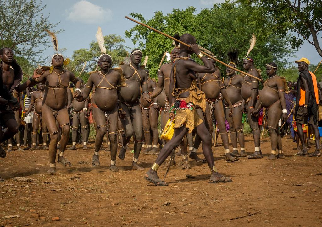 Bodi tribe men celebrating Kael ceremony, Gurra, Hana Mursi, Omo Valley, Ethiopia