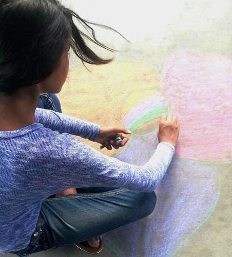 Youth chalking outside Woods Memorial Library. (Urban Poetry Pollinators)