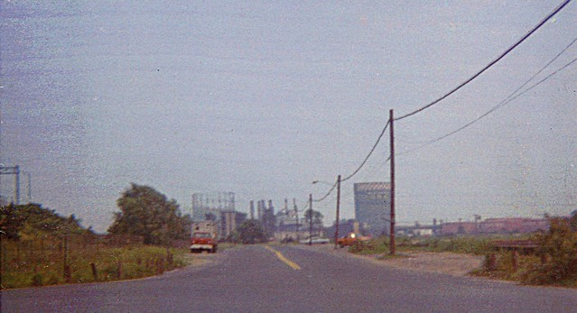 South Frontage Road (today's Long Wharf Drive) was kind of a no-man's land back then. Nice view of the UI Power Plant and its two large gas storage tanks. CT Turnpike at left, harbor on right. New Haven Connecticut. Aug 1972