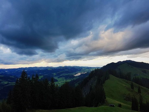 Dramatic clouds sitting over the picturesque landscape of #Entlebuch. #myswitzerland #inlovewithswitzerland by @pgart | by pgart
