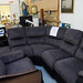 Charcoal corner suite with recliner chair and E415