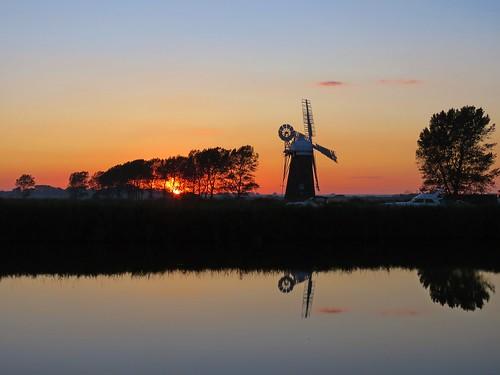 windmill nature fauna river sunset