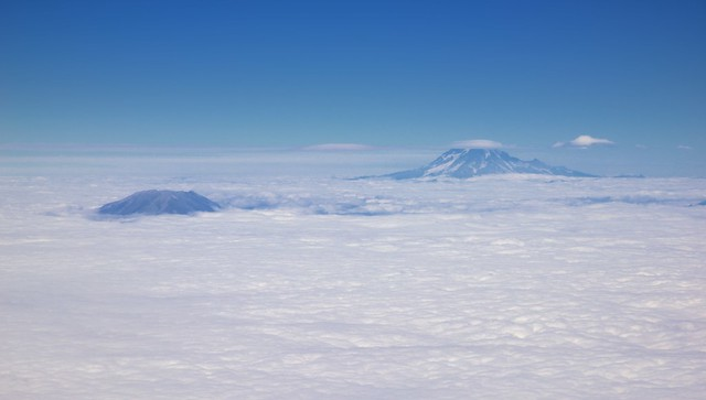 An Airplane Window View to Mount Rainier and Mount Saint Helens